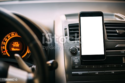 Mobile phone located in the center of the vehicle console