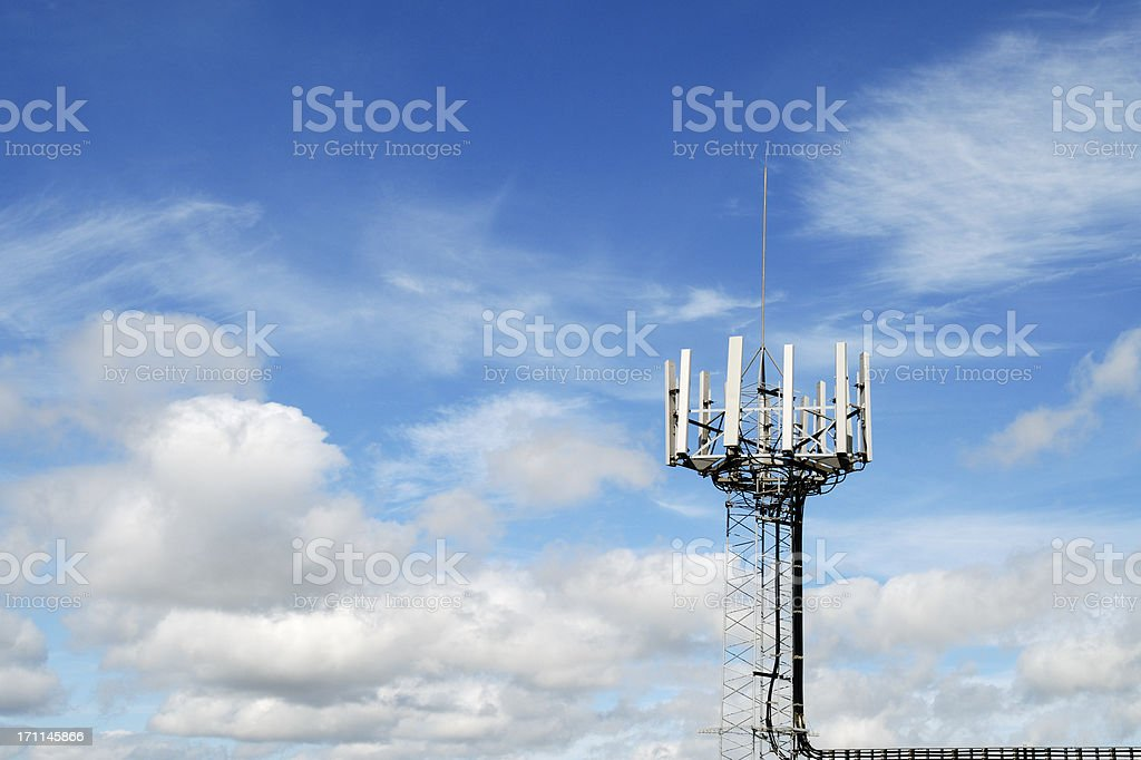 Mobile phone mast against blue sky stock photo
