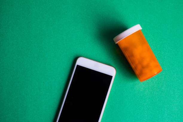 mobile phone & meds - prescription meds stock pictures, royalty-free photos & images