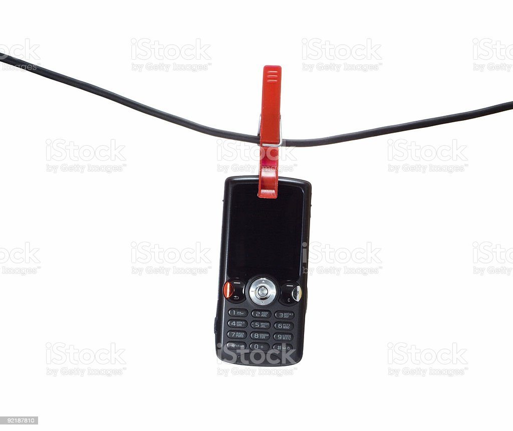 mobile phone on a clothes line royalty-free stock photo
