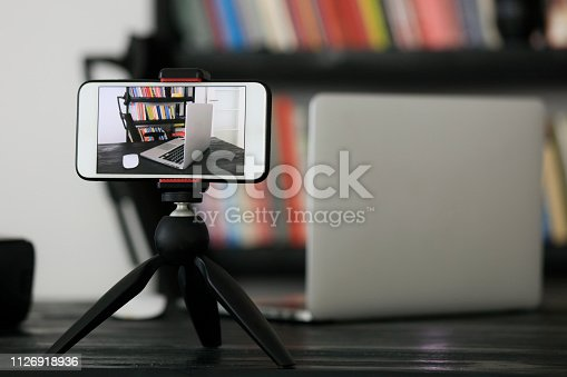 istock Mobile phone on a tripod 1126918936