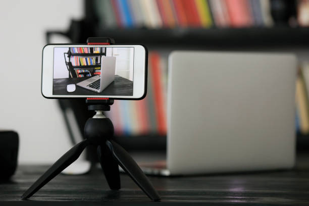 Mobile phone on a tripod Mobile phone on a tripod recording studio stock pictures, royalty-free photos & images