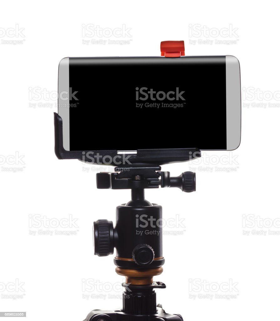 Mobile phone on a tripod stock photo
