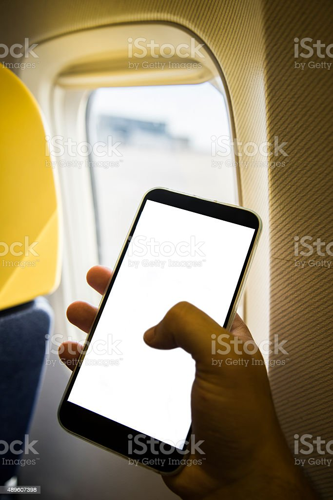 Mobile phone on airplane stock photo