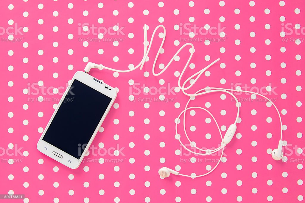 mobile phone on pink vintage paper with dots stock photo