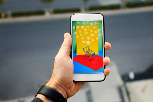 Mobile phone or smartphone with shopping cart stock photo