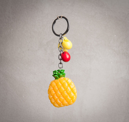 istock Mobile phone pendant in shape of pineapple fruit 941024078