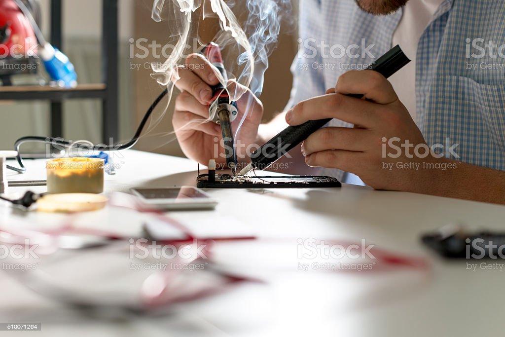 Mobile phone repair stock photo