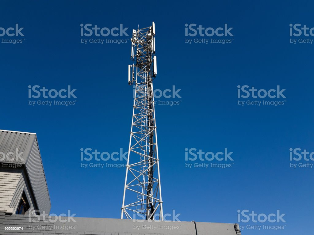 Mobile phone repeater tower against clear sky royalty-free stock photo