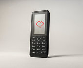Mobile phone sending valentines day love heart message
