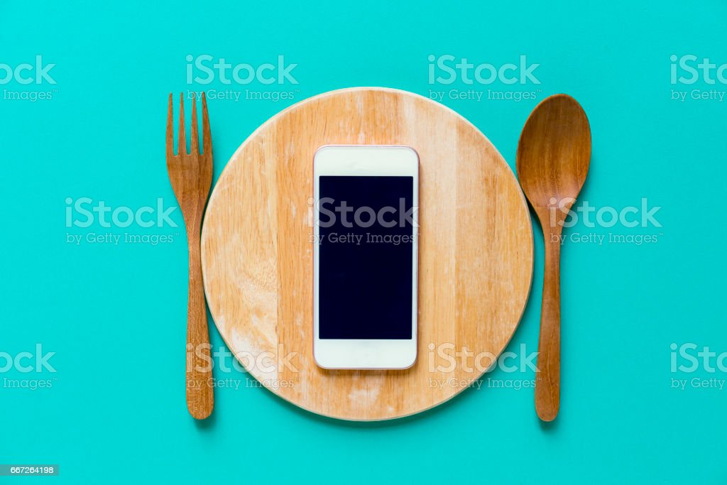 mobile phone served on wood plate, concept and idea stock photo