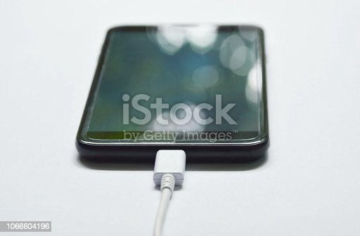 istock mobile phone stabbing in rechargeable battery on white background 1066604196