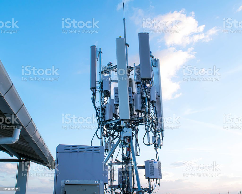 Mobile phone transmitter antenna . Cell phone tower. stock photo