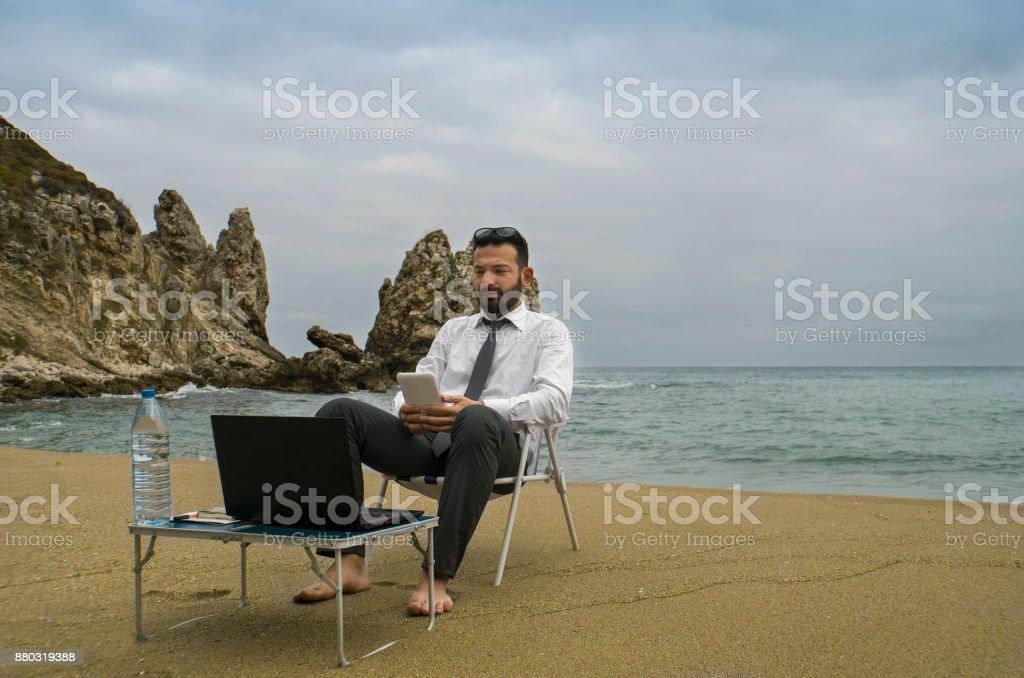 Mobile Phone Use Businessman - Beach Working stock photo