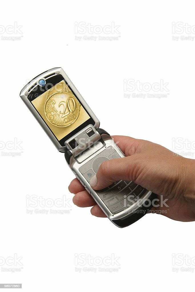 Mobile Phone Whith Coins royalty-free stock photo