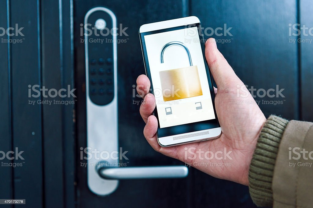 Mobile phone with app unlocks and opens door in house stock photo