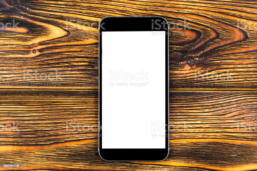 Mobile Phone With Blank Screen Mock Up Isolated On Wood Table