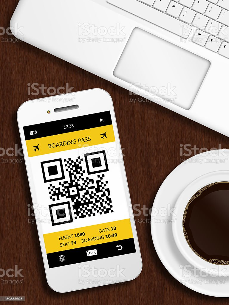 mobile phone with boarding pass lying on table stock photo