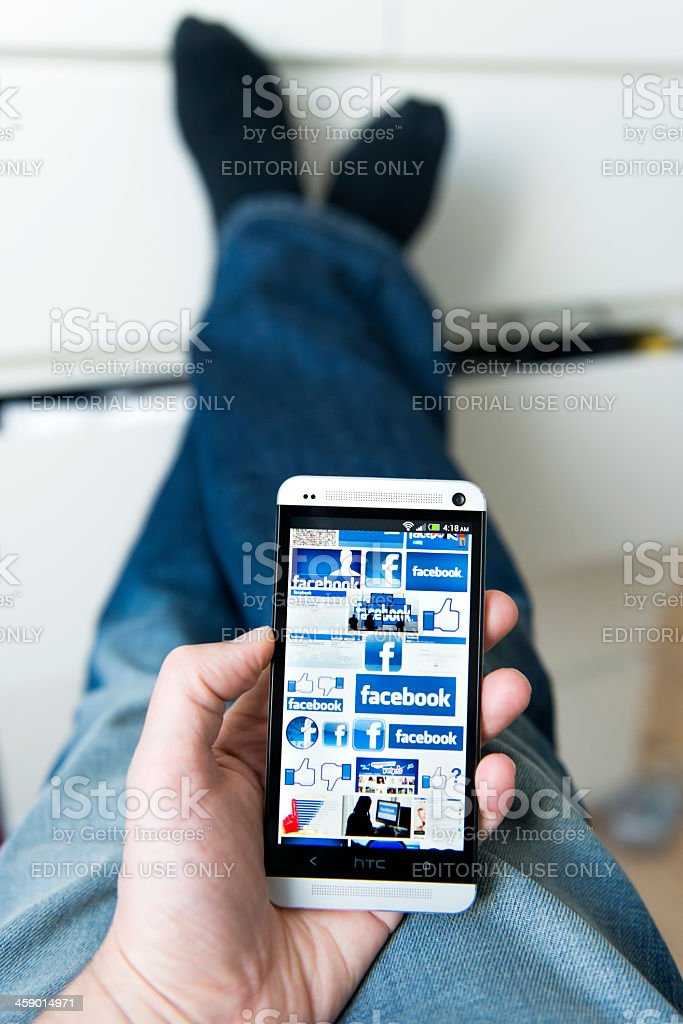 Mobile phone with different logos for Facebook stock photo