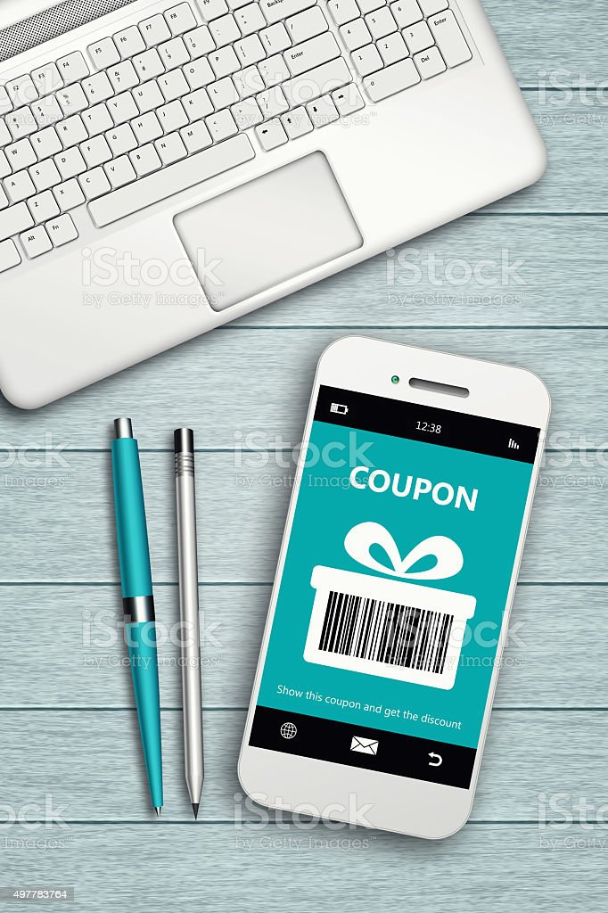 mobile phone with discount coupon computer and coffee stock photo
