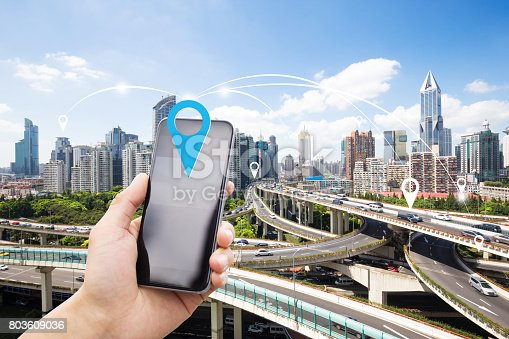 istock mobile phone with elevated road in intelligence city 803609036