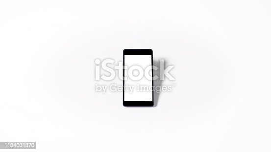 istock mobile phone with empty white screen and white background, isolated 1134031370