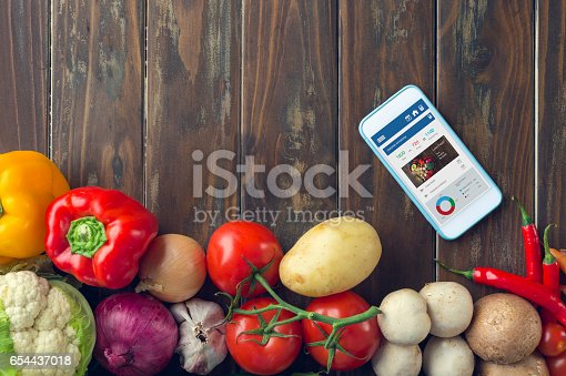 istock Mobile phone with food diary app. 654437018