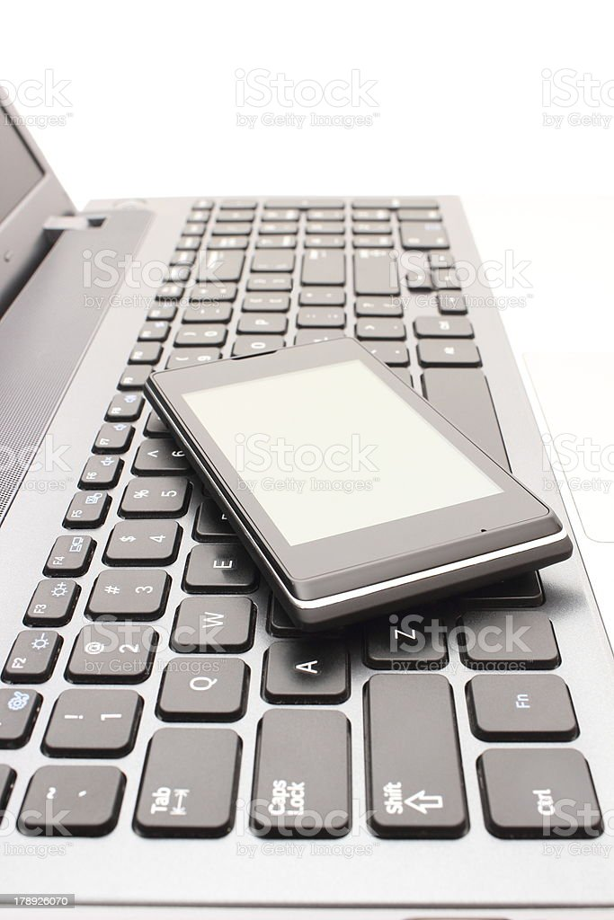 Mobile phone with laptop keyboard royalty-free stock photo