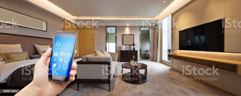 mobile phone with luxury bedroom in smart home stock photo