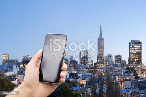 istock mobile phone with modern buildings 804201510