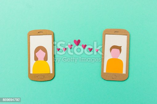 istock Mobile phone with red hearts flying from the screen - paper illustration image concept for online dating, dating apps 859694792