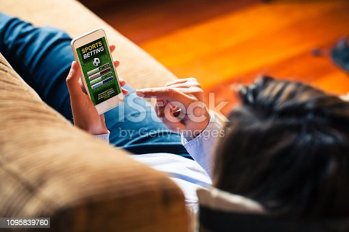 istock Mobile phone with sports betting website app in the screen. 1095839760