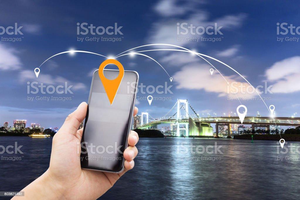 mobile phone with suspension bridge over river stock photo
