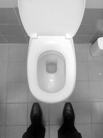 Mobile photo - Man standing on wc