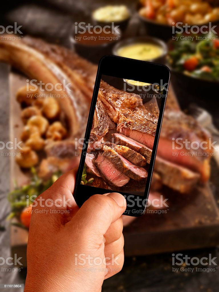 Mobile Photography of The Tomahawk Steak stock photo