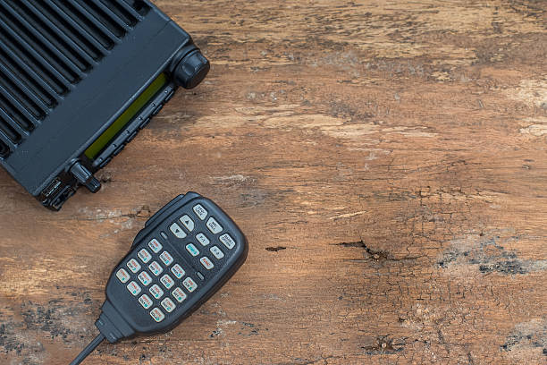 mobile radio transceiver on wood table - ham radio stock photos and pictures