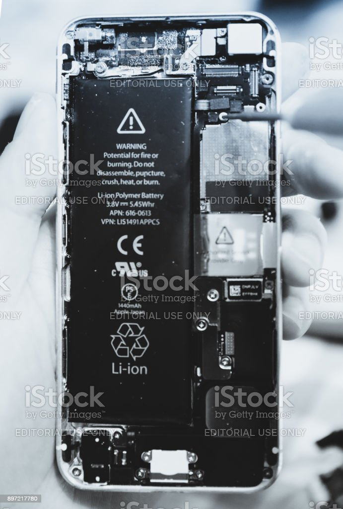 Mobile repair In the process Change iphone 5 screen stock photo