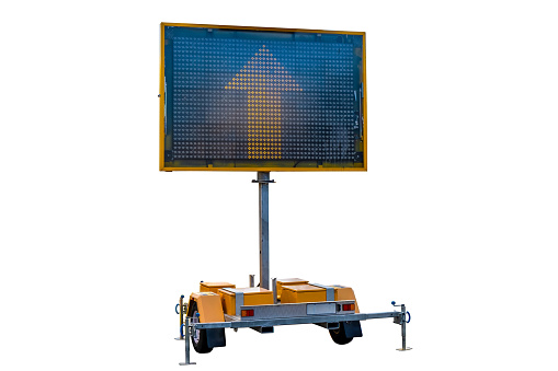 istock Mobile road sign displaying yellow arrow isolated on white background 1194647353