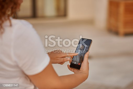 Mobile screen with a woman on video chat