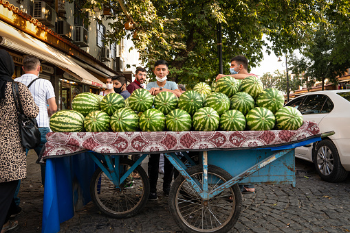 Mobile shop of greengrocer in the street. Water melon seller.