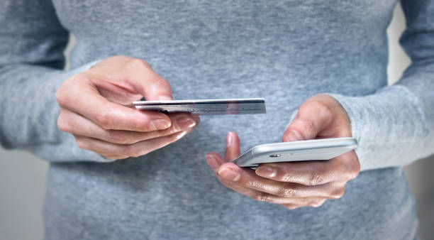 Mobile shopping and banking stock photo