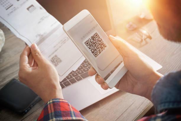Mobile smartphone scanning qr code stock photo