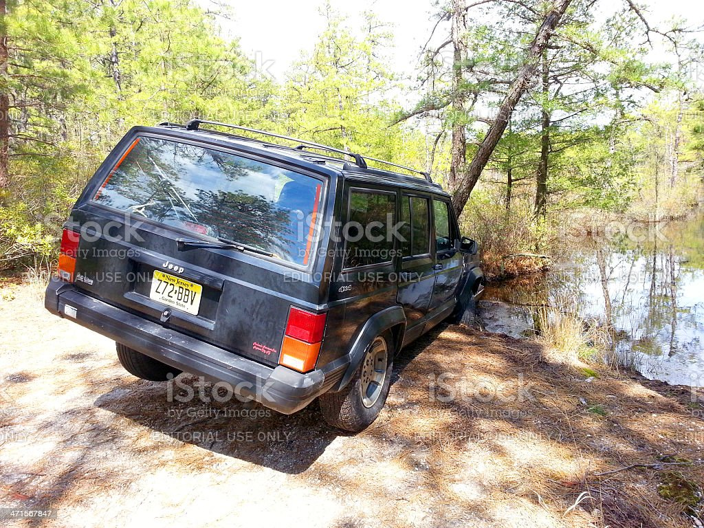 Mobile Stock- Jeep stuck in deep water stock photo