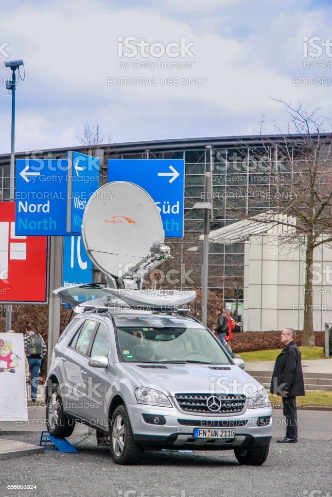 Mobile telecommunication car with ND SatCom SKYRAY Light 1200 antenna  mounted on Mercedes auto at CeBIT trade show in Hannover, Germany on March 3, 2010. stock photo