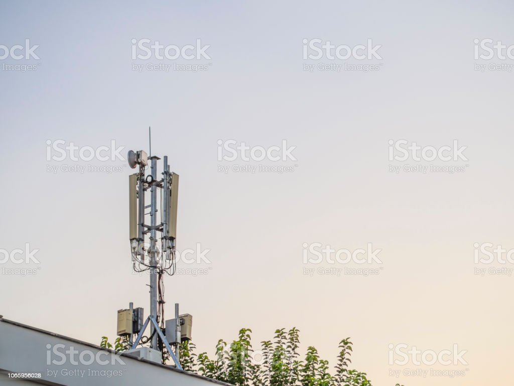 mobile telephone base station built on the roof of the house. radiation-emitting antennas in the city center stock photo