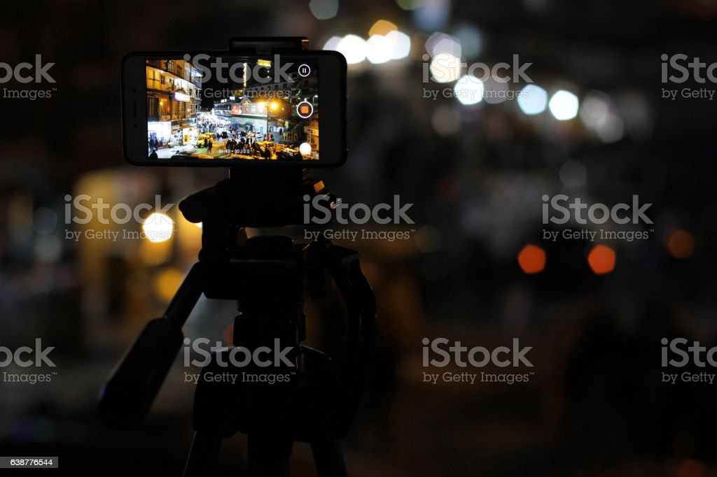 Mobile Timelapes. Mobile recording video at GPO chowk stock photo