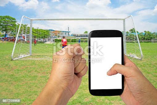 istock mobile with  Soccer Football Match 667259968