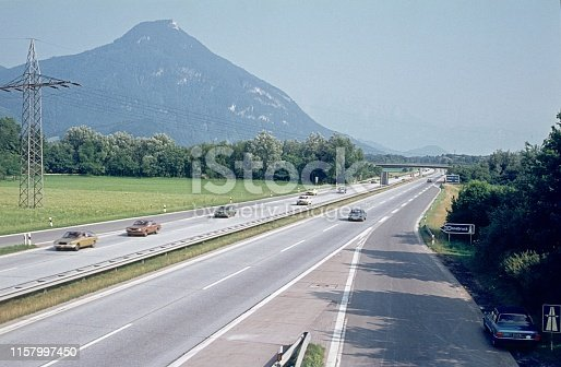 Upper Bavaria, Germany, 1976. Mobility and connections, highway through alpine landscape.