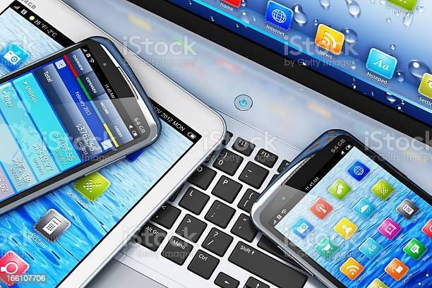 Mobility Concept With Digital Devices On Laptop Stock Photo - Download Image Now