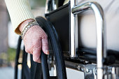 A cropped shot of an elderly woman using a wheelchair